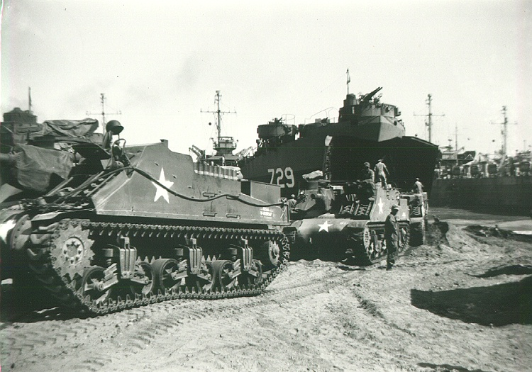 111_Luzon_Loading_tanks_on_to_LST_729