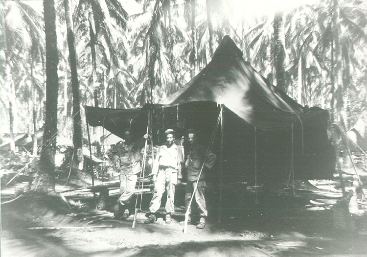 37_Milne_Bay_Tom_Fallen_Cipriano_Torres_and_Herb_Gray_erecting_tent