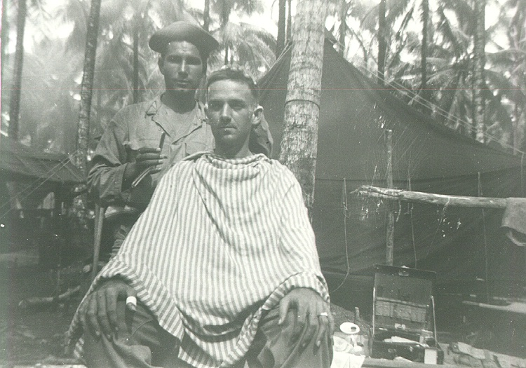 42_Milne_Bay_Tom_Fallen_gets_a_haircut_from_Cipriano_Torres