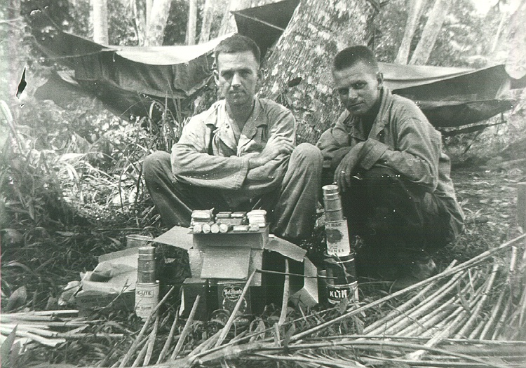 43_Milne_Bay_Tom_Fallen_and_herb_Gray_with_J_rations_the_box_contains_food_for_four_men_for_three_meals_or_one_day