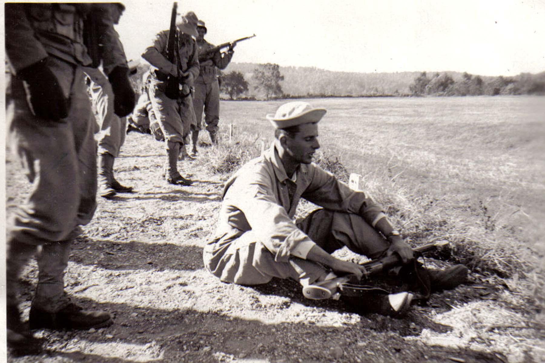 A17 Ft_ Leonard Wood_ MO - Corporal Mark Zelenovich_ platoon leader of squad #1 sitting on firing line