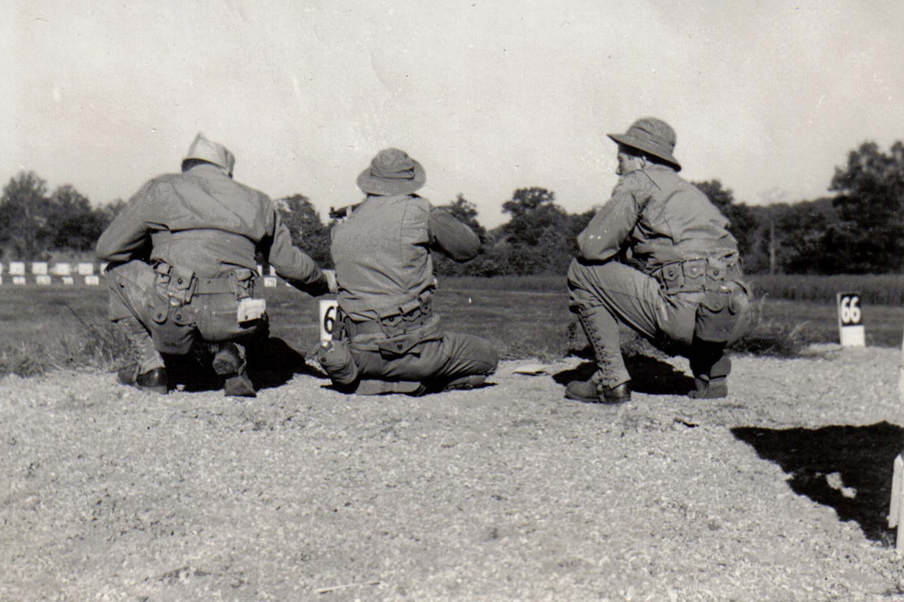 A30 Ft_ Leonard Wood_ MO - Tom Fallen firing from kneeling position with Lt_ Hayden coaching