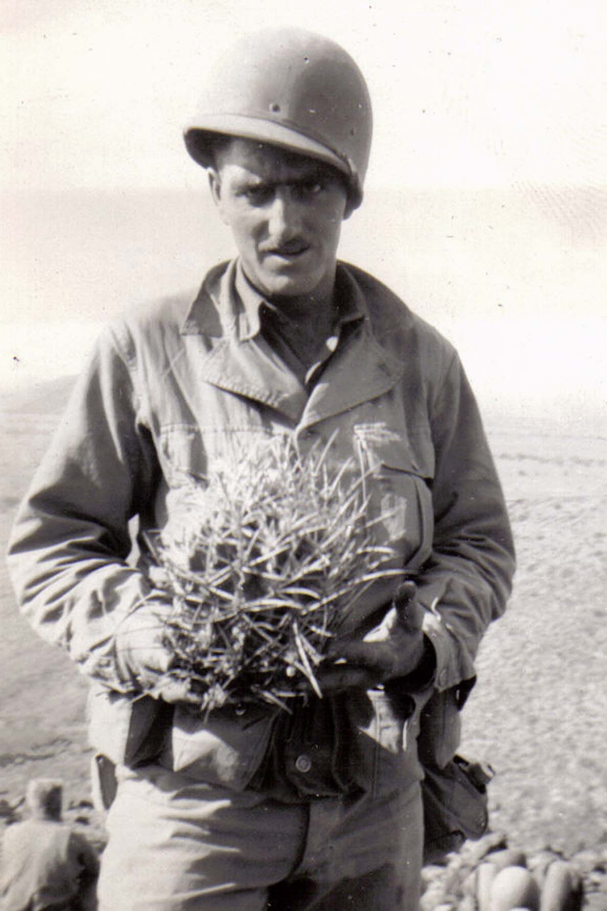 B21 Camp Young_ CA - Unknown soldier holds a cactus