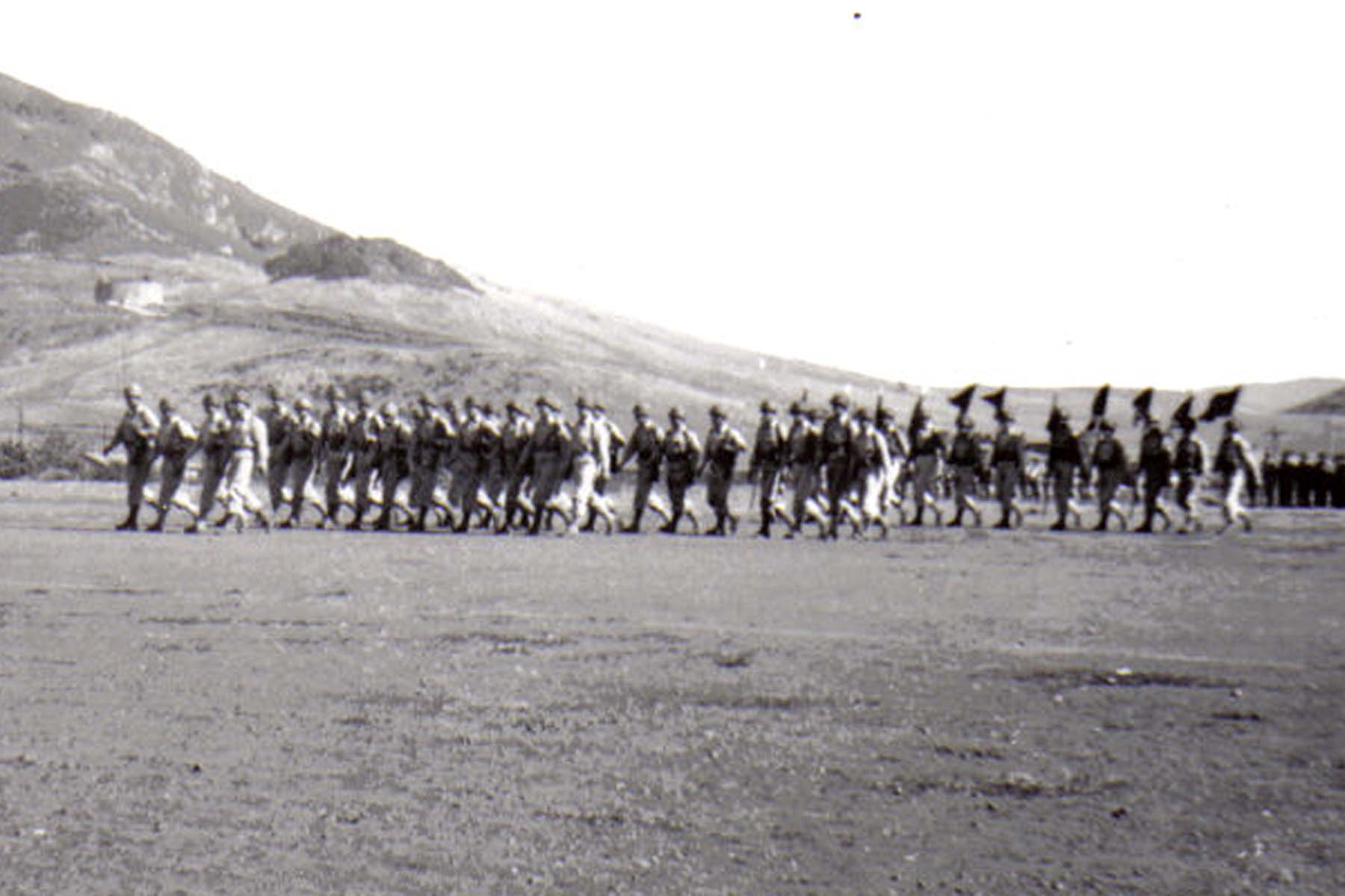 C25 Camp San Luis Obispo - August 2_ 1943 parade - Officers and guidons _front and center_