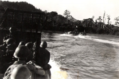 Men_of_3rd_Bt_1st_Inf_Reg_Approach_Sansapor_on_Higgins_Boat_July_31_1944