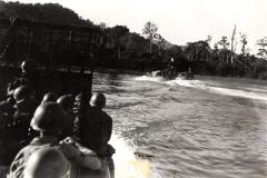 Men_of_3rd_Bt_1st_Inf_Reg_Approach_Sansapor_on_Higgins_Boat_July_31_1944